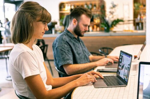 Woman and man using laptop