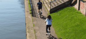 People cycling on tow path