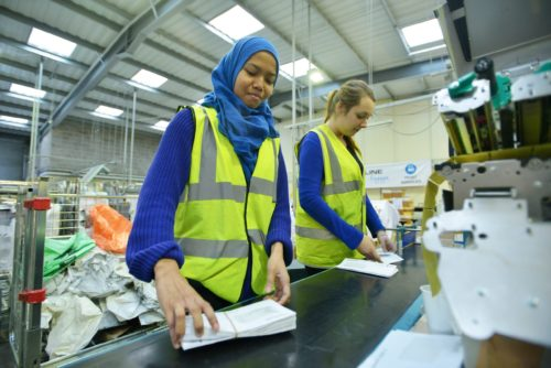 Factory workers on production line