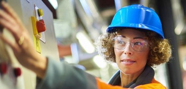 A female industrial service engineer conducts a safety check