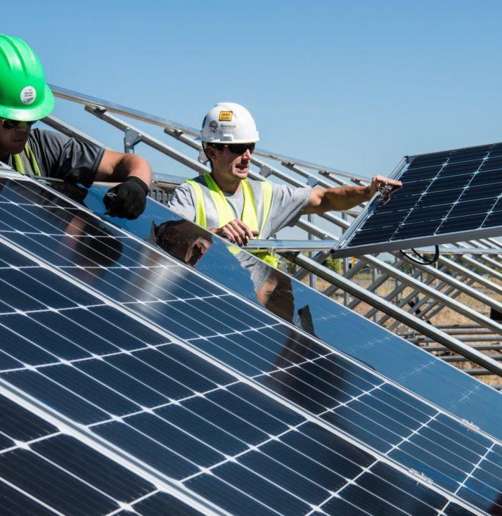 men fitting solar panels