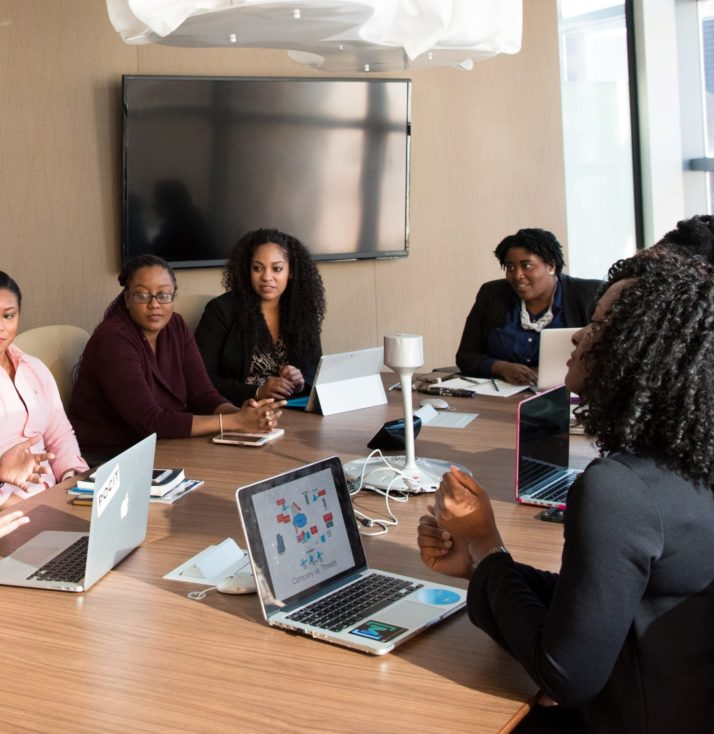 A meeting featuring women of colour