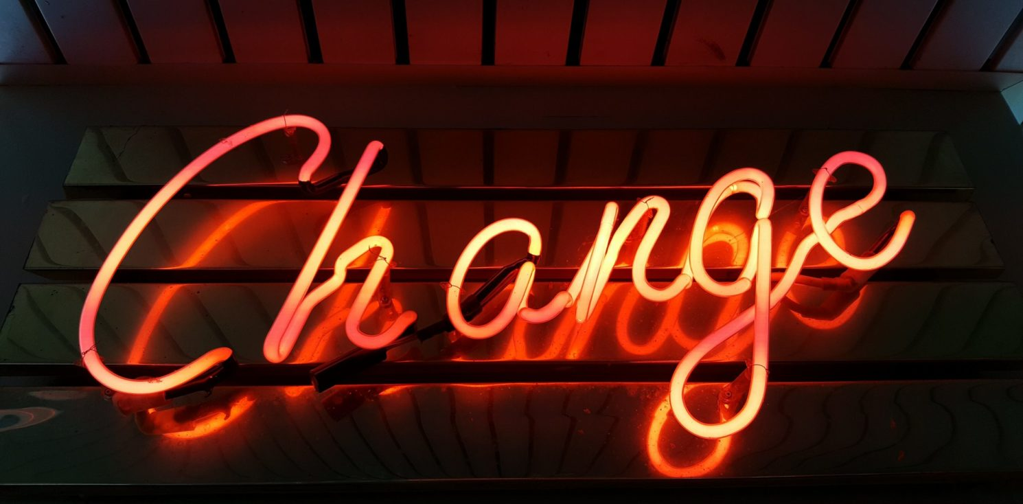A neon sign saying 'Change'